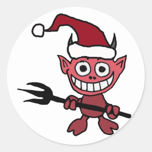 Cute devil wearing santa christmas hat classic round
