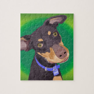 Cute Doberman Mix Dog on a Green Background Puzzles