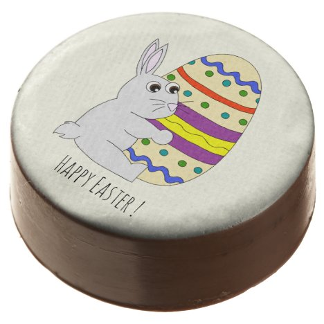 Cute easter bunny holding painted egg chocolate dipped oreo