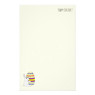 Cute easter bunny holding painted egg stationery