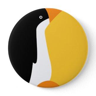 Cute emperor penguin on a button for fashion flair