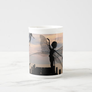 Cute fairy dancing on a jetty tea cup
