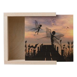 Cute fairy dancing on a jetty wooden keepsake box