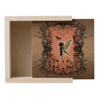 Cute fairy silhouette with glowing shine wooden keepsake box