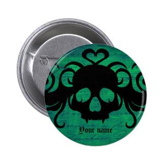 Cute fanged vampire skull dark green button