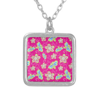 Cute flowers, dragonflies and swirls on pink silver plated necklace
