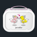 """Cute foxes in love cartoon lunch box<br><div class=""""desc"""">This cute pink and yellow foxes are totally adorable. They are kissing.</div>"""