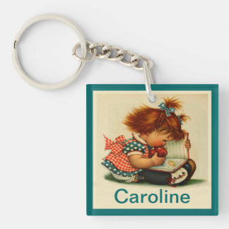 Cute Girl reading a Book  with Name Keychain