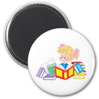 cute girl reading fridge magnet