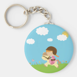 Cute girl riding a horse floral keychain