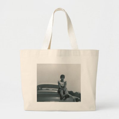 cute girl sitting on back of old car bag by amazingvintage