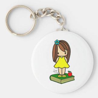 Cute girl teacher with a red apple keychain