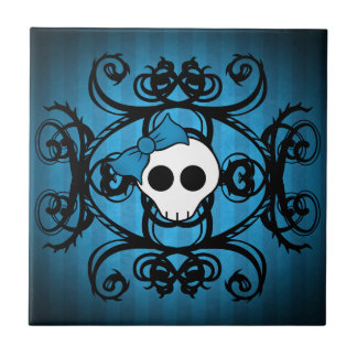 Cute gothic skull on blue and black tile