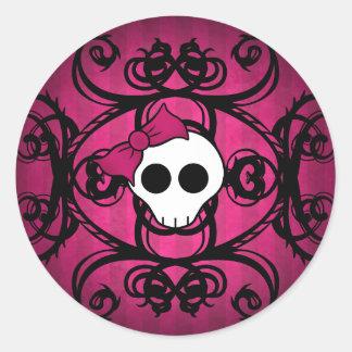 Cute gothic skull on fuschia and black classic round sticker
