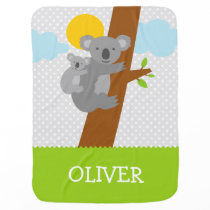 Cute gray koala bear receiving baby blanket