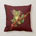 Cute Green Tree Frog with Eye Glasses on Red Pillows