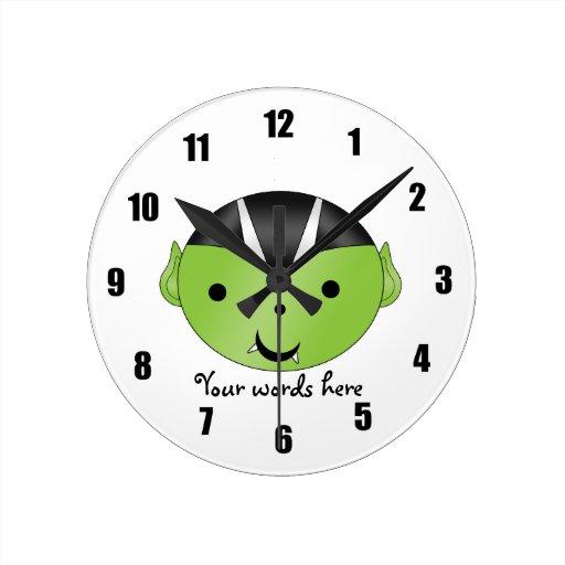 Cute green vampire clocks