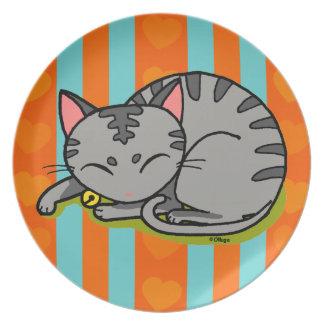 Cute grey cat sleeping plate