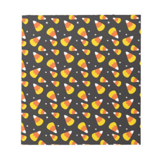 Cute Halloween candy corn on black pattern Notepad