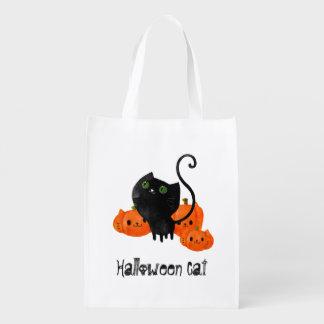 Cute Halloween cat with pumpkins Grocery Bag