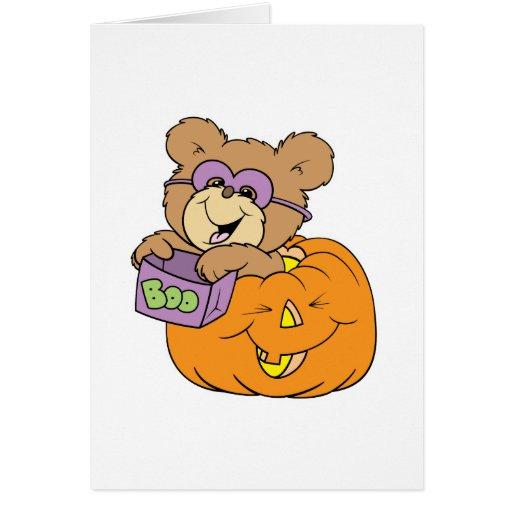 cute halloween teddy bear in pumpkin boo greeting card