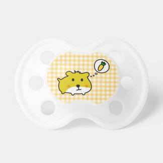 Cute hamster is hungry pacifier