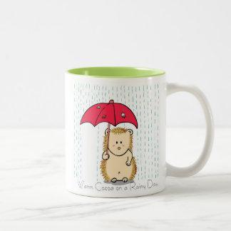 Cute hedgehog with torn umbrella Mug. Two-Tone Coffee Mug