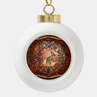 Cute kangaroo with baby in a fantasy landscape ceramic ball christmas ornament
