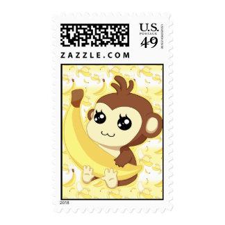 Cute Kawaii monkey holding banana Postage Stamps