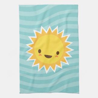 Cute kawaii sun cartoon character on blue kitchen towel