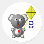 Cute Koala flying a kite Classic Round Sticker