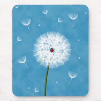 Cute ladybug sitting on top of a dandelion mouse pad