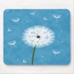 Cute ladybug sitting on top of a dandelion mousepads