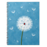 Cute ladybug sitting on top of a dandelion spiral notebook