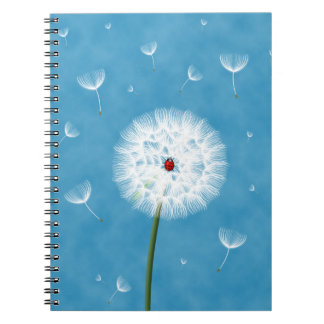 Cute ladybug sitting on top of a dandelion notebook
