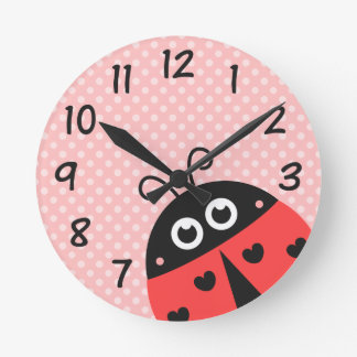 Cute ladybug with black hearts and pink polka dots round clock
