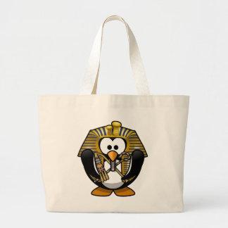 Cute little animated pharaoh penguin tote bags