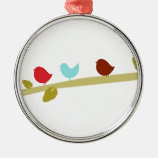 Cute little birds on a limb round metal christmas ornament
