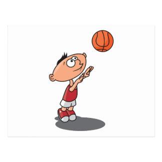 cute little boy shooting a basketball postcard