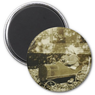 cute little girl in peddle car round magnet