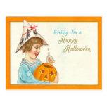 Cute Little Girl Lighting Jack O Lantern Postcard
