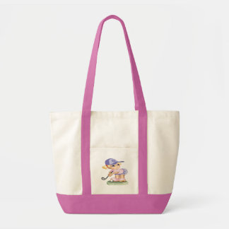 Cute Little girl wearing a blue hat playing golf Tote Bag