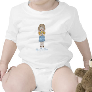 Cute little girl with brown hair and blue skirt rompers