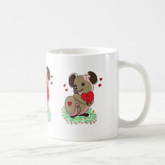Cute little mouse holding a heart coffee mug