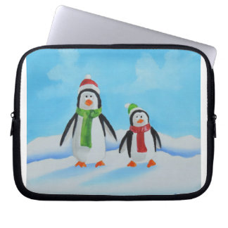 Cute little penguins with scarves laptop sleeves