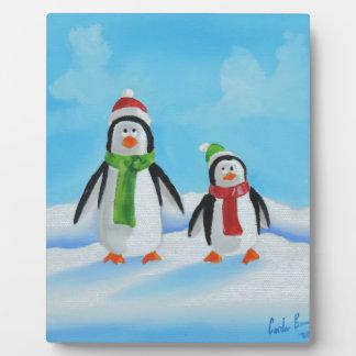 Cute little penguins with scarves plaque