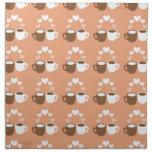 Cute lover coffee cups on peach cloth napkin