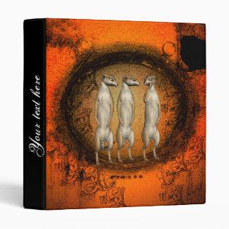 Cute meerkats in a hole binder