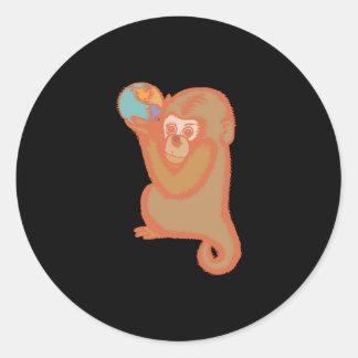 cute monkey holding world classic round sticker