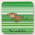 Cute monkey on green and white stripes beverage coaster